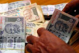 Rupee crashes to 65 against dollar, down 22 paise amid fresh dollar demands