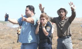 These Palestine men didn't see an enemy when an Israeli policewoman was caught in trouble
