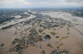 Pictures of Japan floods wreaking havoc as 90,000 flee their homes; radioactive water seeps in