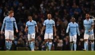 Manchester City ease past Huddersfield to cut Liverpool's lead in Premier League