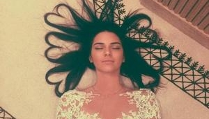 Kendall Jenner poses naked with a cigarette