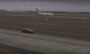 Watch what happens in a race between a Qantas Boeing aircraft and a Tesla Model S