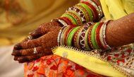 शादी के बाद महिलाएं क्यों लगाती हैं पति का सरनेम?