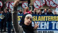 Viral: Hijab-clad woman clicks selfies next to anti-Muslim protesters, wins the internet