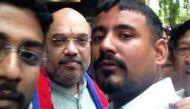 Man accused of attacking JNUSU president Kanhaiya Kumar posts selfies with Amit Shah