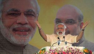 BJP moves in for the UP kill: Modi sells Achhe Din, Amit Shah stokes fears