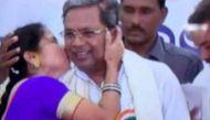 मंच पर चढ़कर एक महिला ने मुख्यमंत्री को कर लिया किस