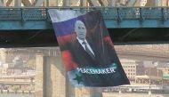 Giant poster of Putin appears on Manhattan bridge, police struggle to identify suspect