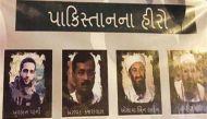 गुजरात: लादेन, हाफिज सईद और बुरहान वानी के पोस्टर में नजर आए केजरीवाल