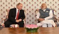 PM Narendra Modi and Russian President Vladimir Putin arrive at New Delhi's Hyderabad House