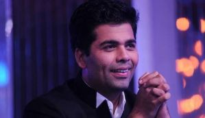 Karan Johar openly blames Ajay Devgn for his fall out with Kajol