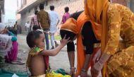 जानिए क्यों इस छह साल के बच्चे की लोग कर रहे हैं पूजा