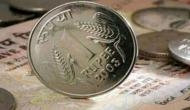 Rupee jumps 11 paise against dollar to 65.25