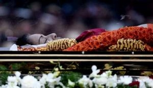 In pictures: Jayalalithaa laid to rest beside her mentor as millions mourn