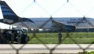 Hijacked Libyan plane: Hijackers release all passengers, surrender