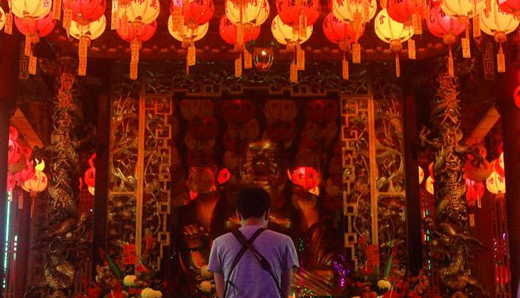 Chinese New Year kicks off with fireworks, lion dances and lanterns