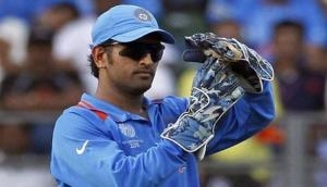 Video: Why MS Dhoni was forced to hide his face on flight