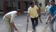 Armed with brooms, UP cops clean police stations