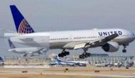 United forces mom to hold boy after giving away his seat