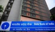 SBI ने ग्राहकों को दिया तगड़ा झटका, पैसा जमा करने पर होगा नुकसान