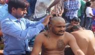 हार्दिक पटेल ने मोदी के गुजरात दौरे के विरोध में मुंडवाया सिर
