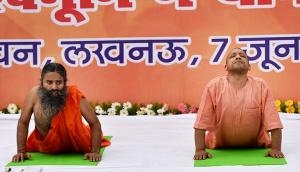 In pictures: Yogi's solution to crime in UP – Keep calm and do yoga with Ramdev