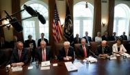 Trump showered with 'glowing tributes' in his first Cabinet meeting
