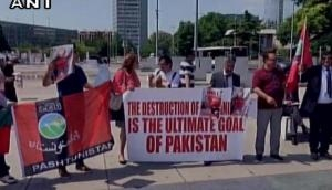 Geneva: Balochs protest against Pak atrocities in front of iconic 'Broken Chair'