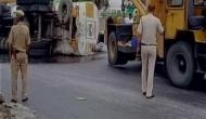 Delhi: Petrol spills on road as tanker overturns, traffic affected