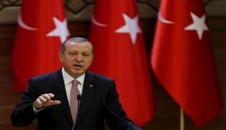 In election manifesto, Erdogan Guarantees new military Attempts