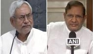 JD(U) passes resolution to join NDA, RJD calls it 'meaningless'