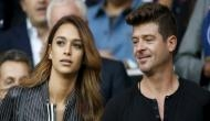It's 'baby on board' for Robin Thicke, April Love!