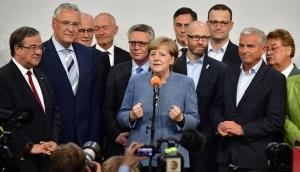 Angela Merkel wins a fourth term in office – but it won't be an easy one