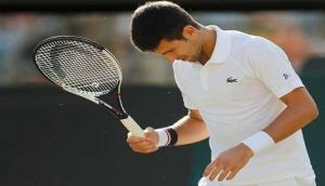 Agassi to continue as Djokovic's coach in 2018