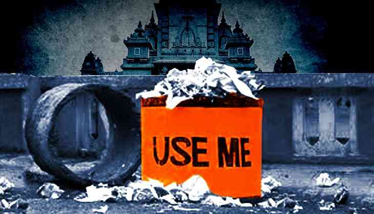 The literal saffronisation of Lucknow: after buses & electric poles, it's bins at temples
