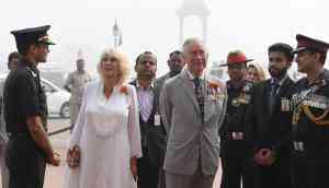 In Photos: Prince Charles and Camilla greeted with the capital's smog