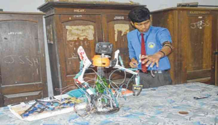 Manipuri student makes robot with discarded household items