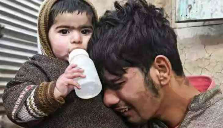 Viral pictures of 2 newly orphaned infants become latest symbols of the tragedy in Kashmir