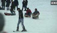 Tourists enjoy snowfall at Gulmarg, steady business for sledge owners