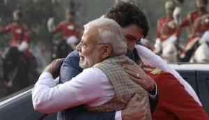 Finally, Trudeau gives  Modi's trademark 'Bear Hug'