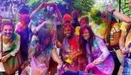 Colour-smeared people celebrate Holi across nation