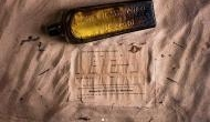Woman stumbles on 133-year-old gin bottle with a message in Australia