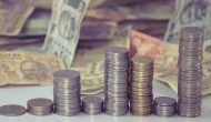 Rupee trading higher 4 paise against US dollar