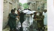 Picture of funeral procession through sewerage water calls for an investigation