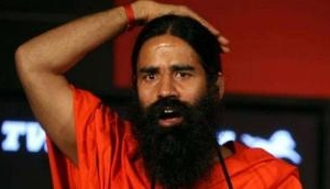 Man arrested for posting Ramdev's morphed photo in WhatsApp group