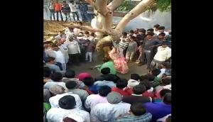 Viral Video: Bulandshahr man beats his wife infront of Panchayat mercilessly; what happened next will shock you