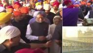 Manmohan Singh pays obeisance at Golden Temple