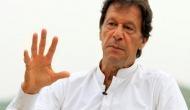 Belligerent Imran says Pak PM trying to save Nawaz Sharif