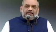 Amit Shah stages sit-in at Hubballi, lashes out at Congress
