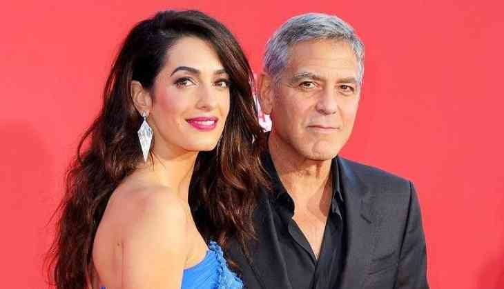 Clooney fascinated by wife Amal